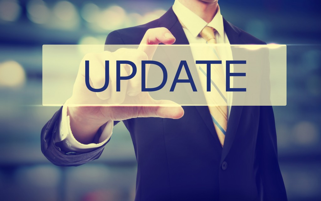 Business man holding Update on blurred abstract background